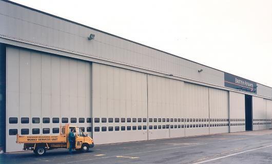 Porte Industrielle Coulissante En Acier Isolante Pour Hangar - Rail porte coulissante hangar