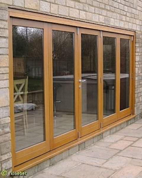 baie vitr e coulissante empilable pliante en bois double vitrage kustomfold kloeber. Black Bedroom Furniture Sets. Home Design Ideas