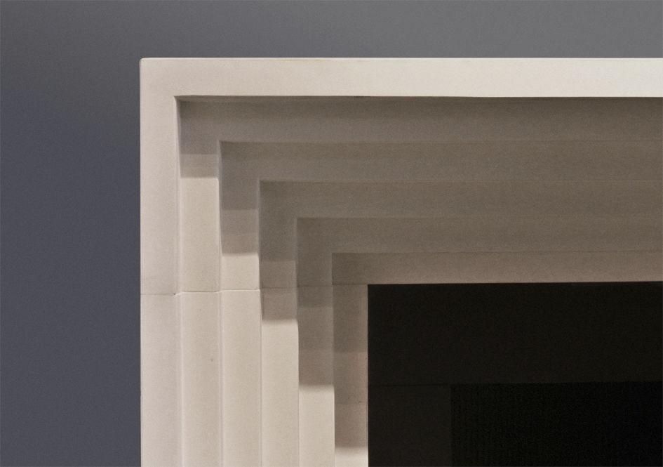 Manteau de cheminée contemporain / en calcaire - THE ODEON - Chesneys