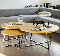 Table basse contemporaine / en métal / en cuir / ronde