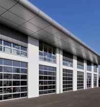 Porte industrielle sectionnelle / en aluminium / à isolation thermique / automatique