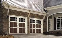 Portes de garage battantes / en acier / automatiques