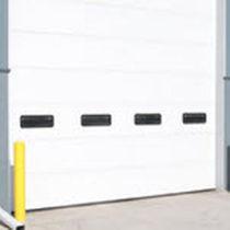 Porte industrielle sectionnelle / en acier galvanisé / isolante / automatique