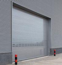 Porte industrielle enroulable / en aluminium / résistante au vent / isolante