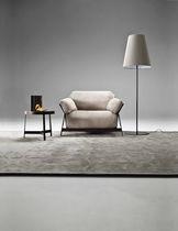 Fauteuil contemporain / en tissu / en cuir / en fer