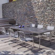 Table à manger contemporaine / en ciment / en chêne / en teck