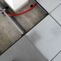 Plancher technique en grès cérame / en inox / à haute résistance / radiant