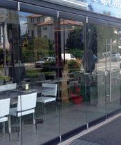 Cloison pliante / vitrée / à usage professionnel / sans montant vertical