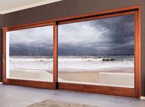 Système coulissant pour porte en verre