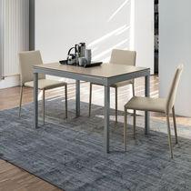 Table à manger contemporaine / en grès cérame / en métal peint / en MDF