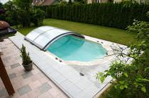 Abri de piscine bas / coulissant / d'aluminium / avec actionnement manuel
