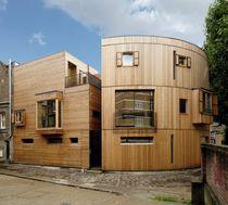 Bâtiment préfabriqué / pour logement collectif / en bois massif / à ossature bois