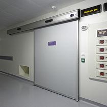 Porte industrielle coulissante / en métal / acoustique / vitrée