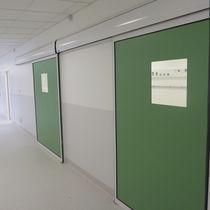 Porte industrielle coulissante / en métal / semi-vitrée / intérieure