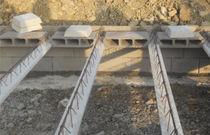Plancher poutrelles-hourdis / système d'étaiement breveté