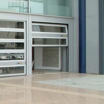Porte industrielle sectionnelle / en aluminium / automatique / de sécurité