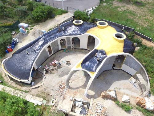 maison individuelle / design original / en béton / écologique