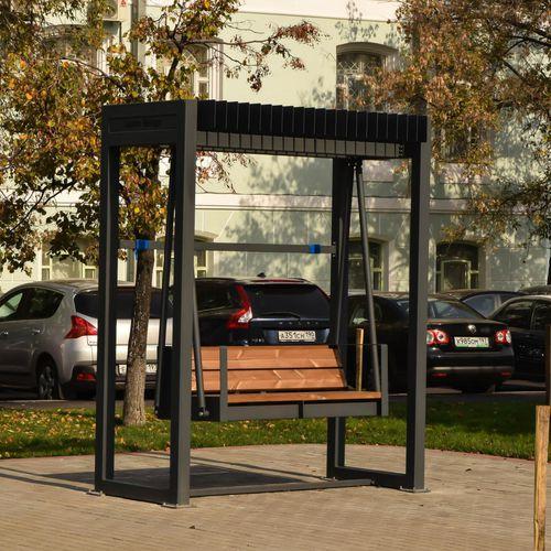 balancelle en bois / en acier à revêtement par poudre / pour espace public