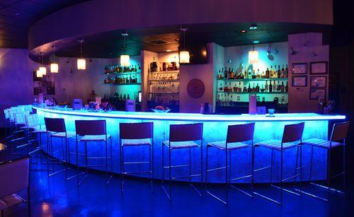 comptoir de bar / en verre / en arc de cercle / lumineux