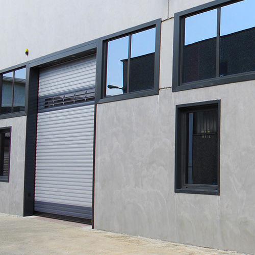 Porte industrielle enroulable / en acier galvanisé / automatique / résistante au vent FAST-WALL KOPRON