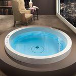baignoire ronde / en acrylique / hydromassage / par Marc Sadler