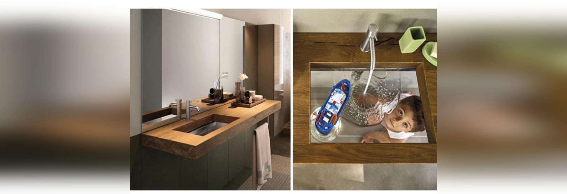 Cet évier de salle de bains a été conçu avec un fond en verre transparent