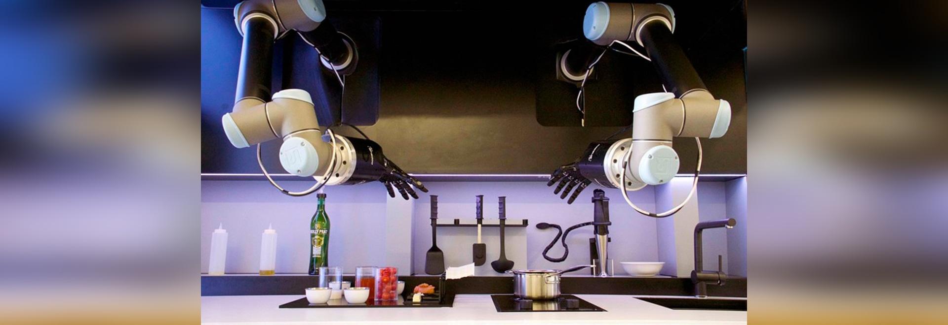 le moley a automatisé des paires d'utilisations de cuisine de bras robotiques pour préparer des repas