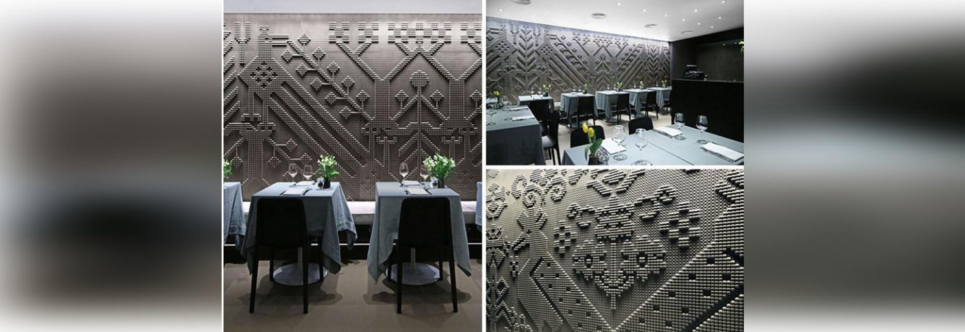 Les tapisseries en pierre ciselées couvrent les murs de ce restaurant à Londres