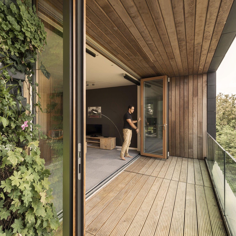 Baie vitrée accordéon - COMBILINE - Solarlux - en aluminium / en bois / à double vitrage