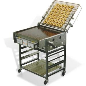 table de préparation pour glaçage à beignets