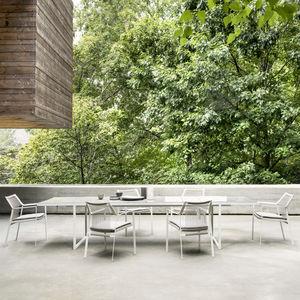 table à manger contemporaine / en pierre de lave émaillée / avec piètement en acier inoxydable / rectangulaire