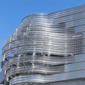 tôle métallique nervurée / cintrée / en métal / pour toiture