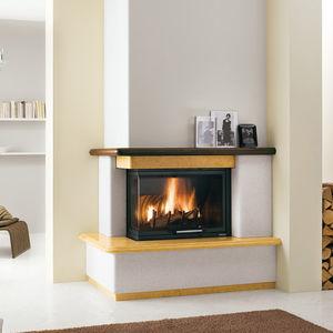 manteau de cheminée contemporain / en bois / en pierre / d'angle