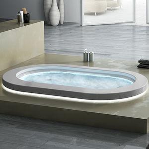baignoire ovale / en Corian® / en acrylique / hydromassage