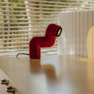 lampe de table / design original / en ABS / réglable