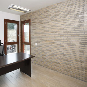 parement en pierre naturelle / intérieur / finition naturelle / sable