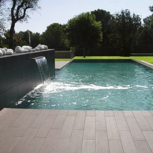 piscine en blocs à bancher en polymère / naturelle / enterrée / en bois