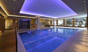 piscine en panneaux / enterrée / en acier / d'intérieur
