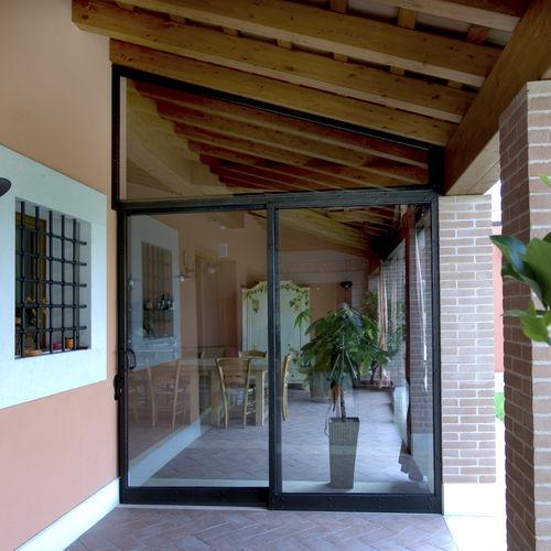 baie vitrée coulissante / en fer forgé / à double vitrage