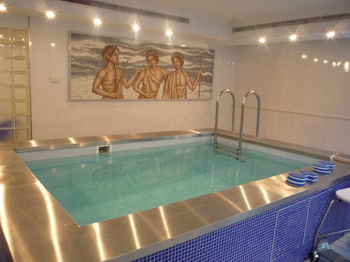 piscine hors-sol / en acier inoxydable / en mosaïque / d'intérieur