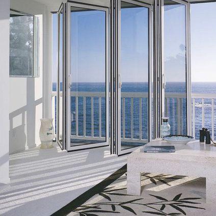 baie vitrée coulissante-empilable / en aluminium / à double vitrage / à coupure thermique