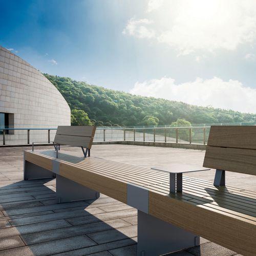 banc public / contemporain / en bois exotique / en acier peint