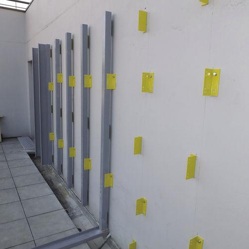 système de fixation en composite / pour mur-rideau / pour mur / pour façade