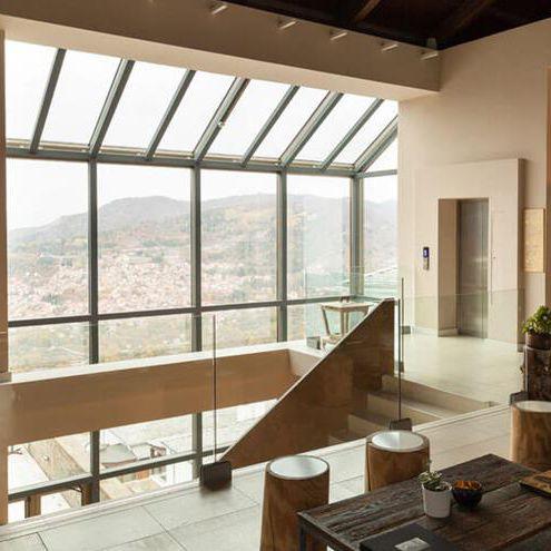 mur-rideau en panneaux / en aluminium et en verre / avec isolation intégrée