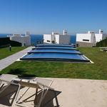 abri de piscine bas / télescopique / en aluminium / avec actionnement manuel