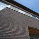 brique de parement de terre cuite / pour façade / à relief / fait main