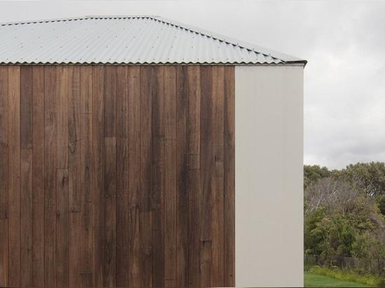 edition office construit une résidence monolithique de quatre pavillons reliés entre eux en australie